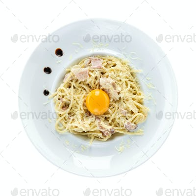 Spaghetti carbonara over white, view from above. With path.