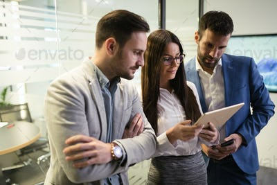 Picture of businesspeople using digital tablet in office