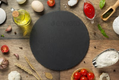 pizza food ingredients and slate stone