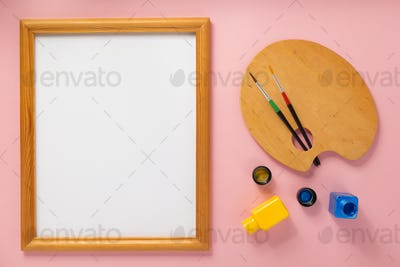 palette and picture frame on abstract