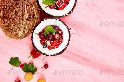 Fruit salad agrus, gooseberry, rasbberry in coconut