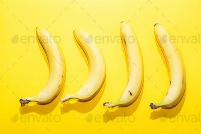 Bananas on yellow pastel background. minimal idea food concept
