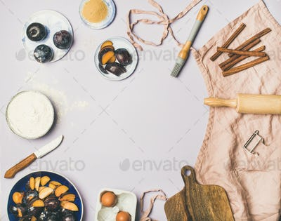 Baking ingredients and tools over pastel lilac background, copy space