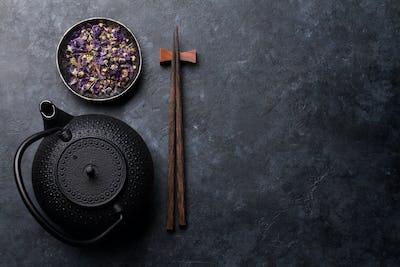 Teapot, dry tea and sushi chopsticks