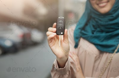 Muslim woman in hijab with car key