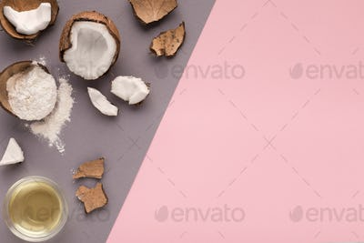 Coconut flour, water and nuts on pink background