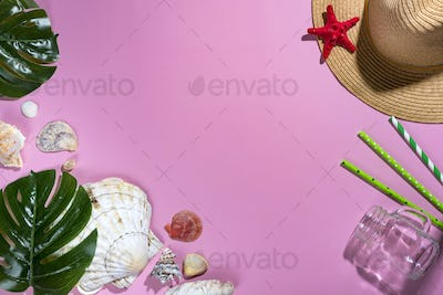 Tropical palm leaves, hat, seashells on pastel violet background with glass glass