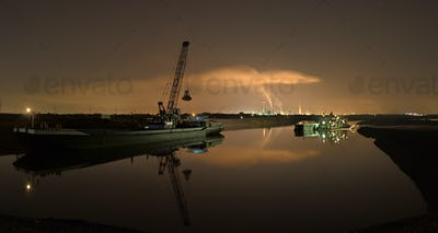 Dredger And Heavy Industry At Night