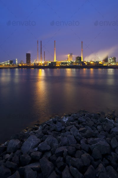 Coking Plant By River At Night