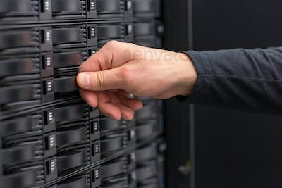 Close-up of IT Consultant Maintain SAN and Servers in Datacenter
