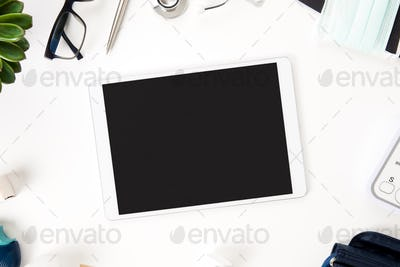 Tablet Computer With Blank Screen And Medical Equipment On Table