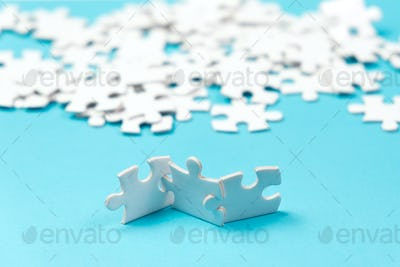 Three pieces of white jigsaw puzzle