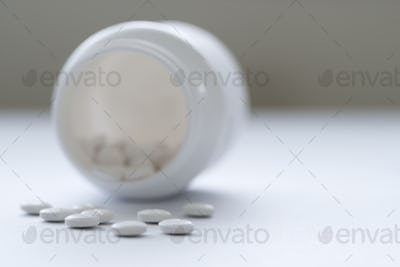 Prescription medicine in white bottle