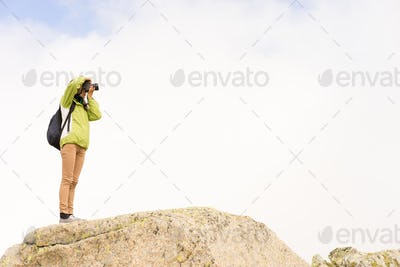 Photographer on a rock