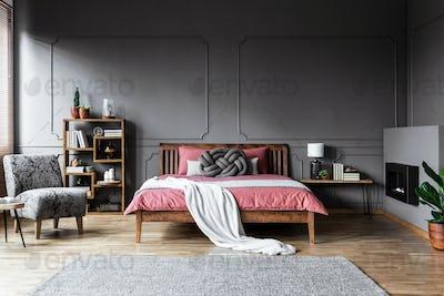 Spacious grey bedroom interior