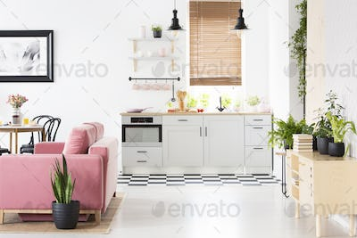 Real photo of open space kitchen interior with checkerboard floo