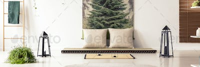 Panorama of beige cushions on futon in a peaceful bedroom interi