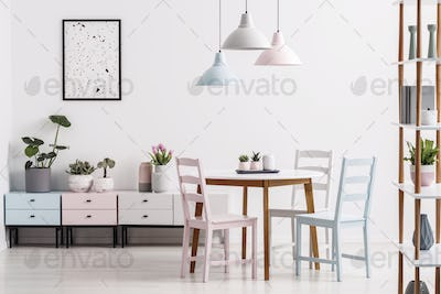 Real photo of a pastel dining room interior with a table, chairs