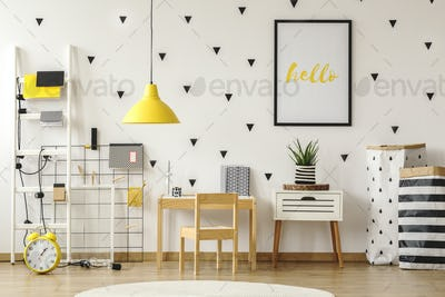 Poster in a black frame on a white wall with stickers in a scand