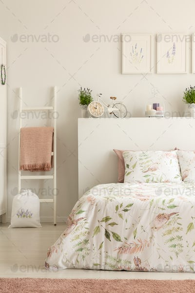 Real photo of white bedroom interior with bicycle shaped clock,
