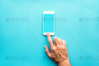 Hand using smartphone with blank mock up screen