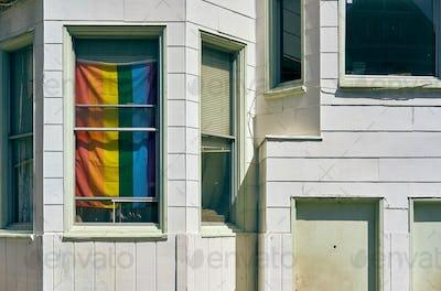 Rainbow flag in window