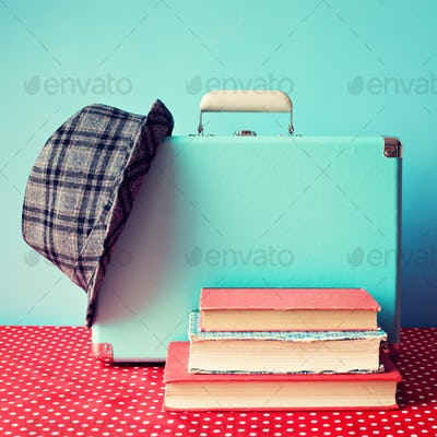 Retro and hipster books and suitcase