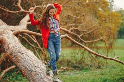 Hipster girl having fun in the park
