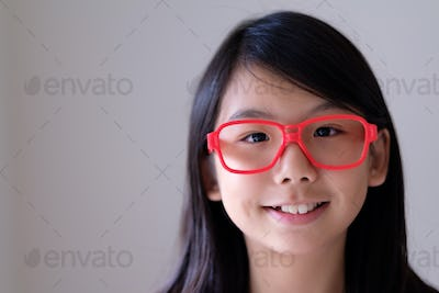 Portrait of Asian teenager with big red glasses