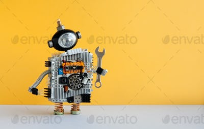 Hand wrench robot serviceman worker on yellow background.