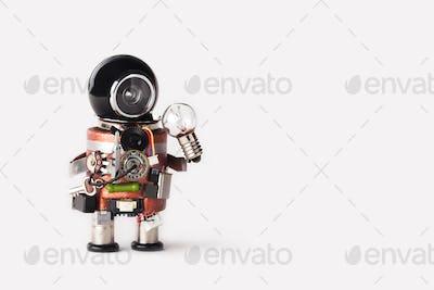 Creative idea inspiration concept. robot handyman with lamp bulb.