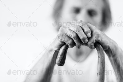Elderly woman with a walking stick