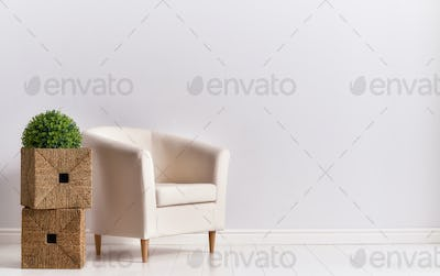 armchair on empty wall