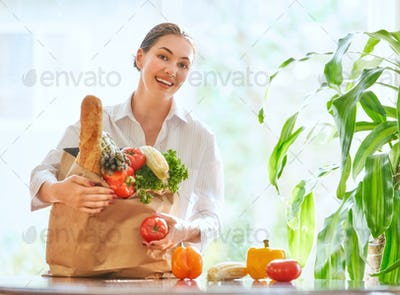 woman holding grocery shopping bag