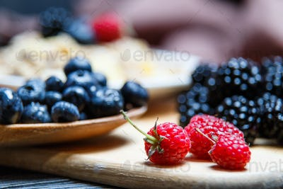 Berries mix blueberry, raspberry on rustic wooden table