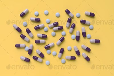colorful pills isolated on yellow background