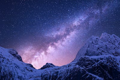 Purple milky Way above snowy mountains. Space