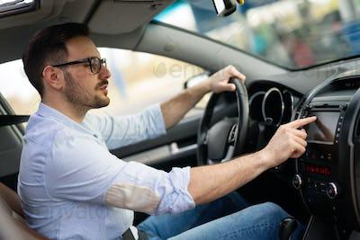 Man Using Gps Navigation System In Car