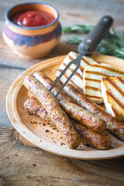 Grilled sausages and cheese with rosemary