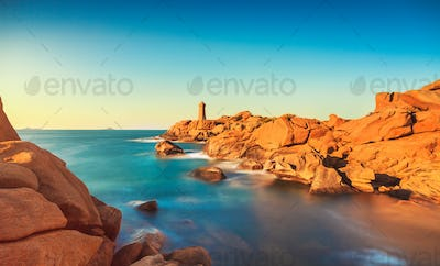 Ploumanach lighthouse sunset in pink granite coast, Brittany, Fr