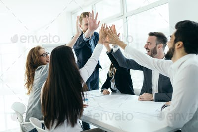 Business people working together on project and brainstorming in office