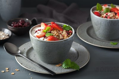 granola and yogurt with seeds and strawberry for breakfast