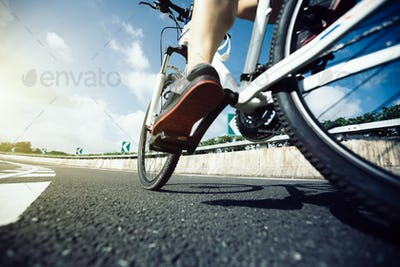 Legs cycling on highway