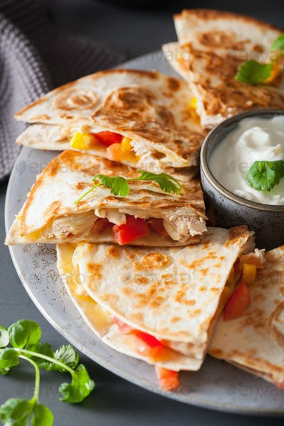 mexican quesadilla with chicken, tomato, sweet corn and cheese