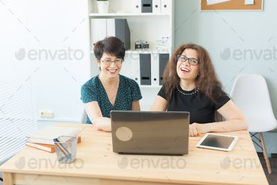 People, technology and communication concept - Cute female workers are resting in office