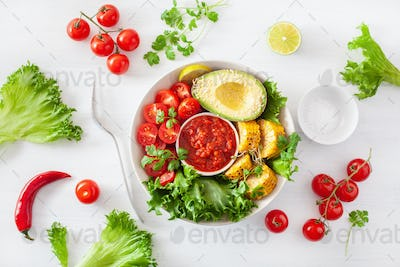 vegan buddha bowl. healthy lunch bowl with avocado, tomato, swee