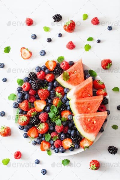 fruit and berry platter over white. blueberry, strawberry, raspb