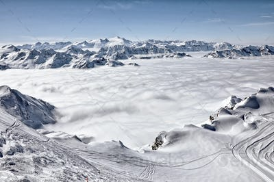 Ski resort in the Alps. Ski slopes, piste, powder snow in the mountains