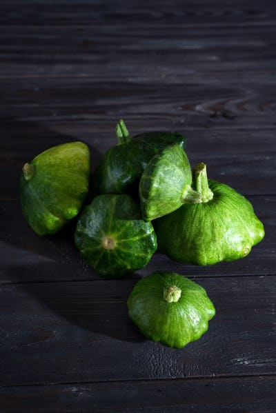 small size patty pan patisson squash on dark wooden background with copy space