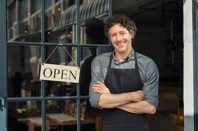 Owner standing outside restaurant